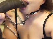 Submissive woman swallowing the black dick